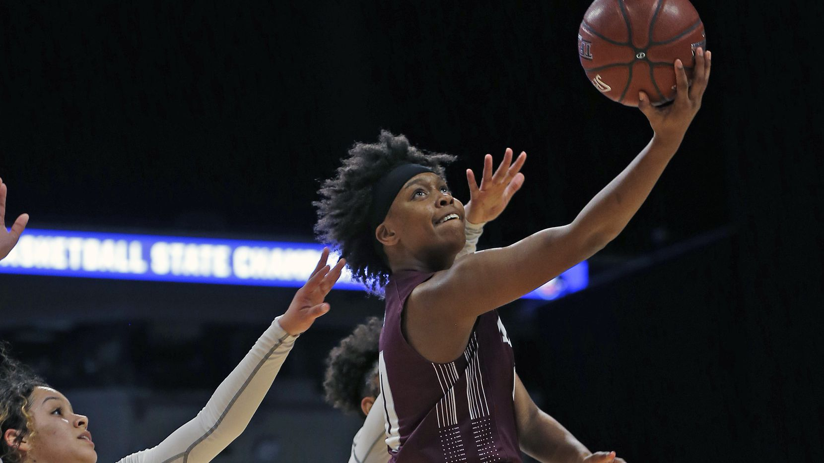 Mansfield Timberview guard Desiree Wooten tries to score on a reverse layup in a 5A semifinal match on Thursday, March 5, 2020, at the Alamodome. San Antonio Veterans defeated Mansfield Timberview 45-44.
