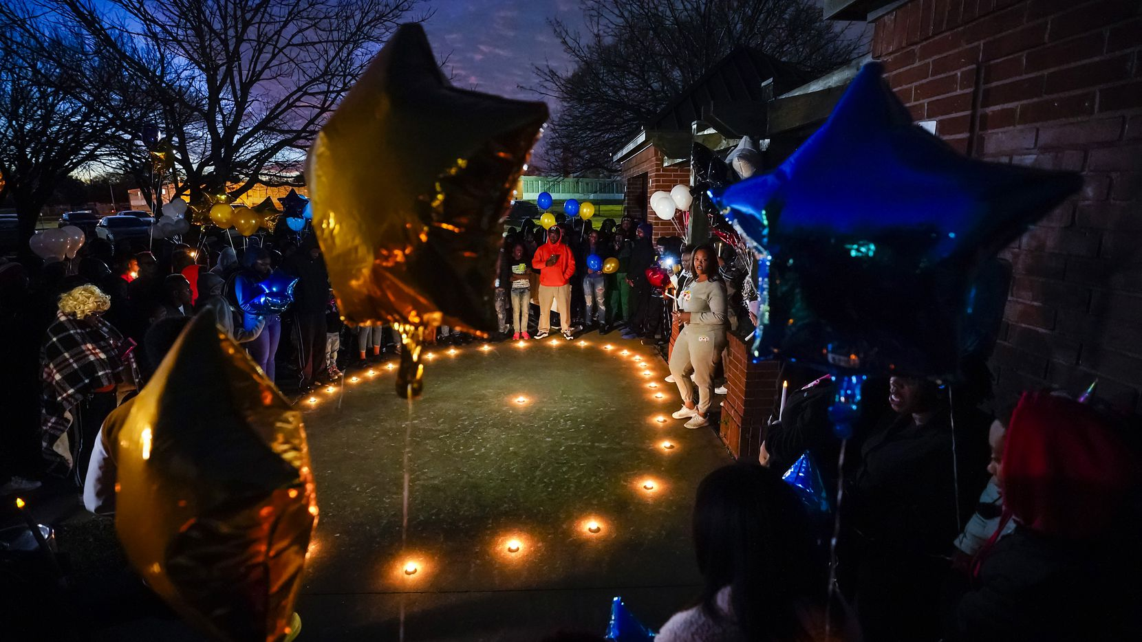 """Jennifer Edwards speaks during a vigil for Marc """"Flea"""" Strickland, an 18-year-old victim of a shooting at Dallas ISD basketball game, at Bushman Park on Sunday, Jan. 19, 2020."""