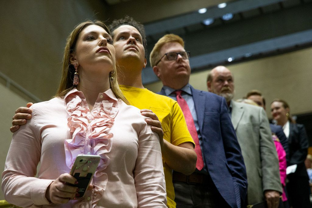 From left, Janie Bergamasco and Javier Rodriguez wait in line to speak in support of Planned Development 15 at the city council meeting on Wednesday, Sep. 11, 2019, at Dallas City Hall. City council voted in favor of a controversial zoning plan that will allow high-rise residences in the affluent Preston Hollow neighborhood, where a sizable opposition has fought such development for years.