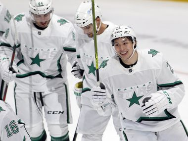 Dallas Stars' Jason Robertson (21) was all smiles after assisting teammate Joe Pavelski (16) for a first period goal in their game against the Detroit Red Wings. The two teams played their NHL game at the American Airlines Center in Dallas on April 20, 2021.