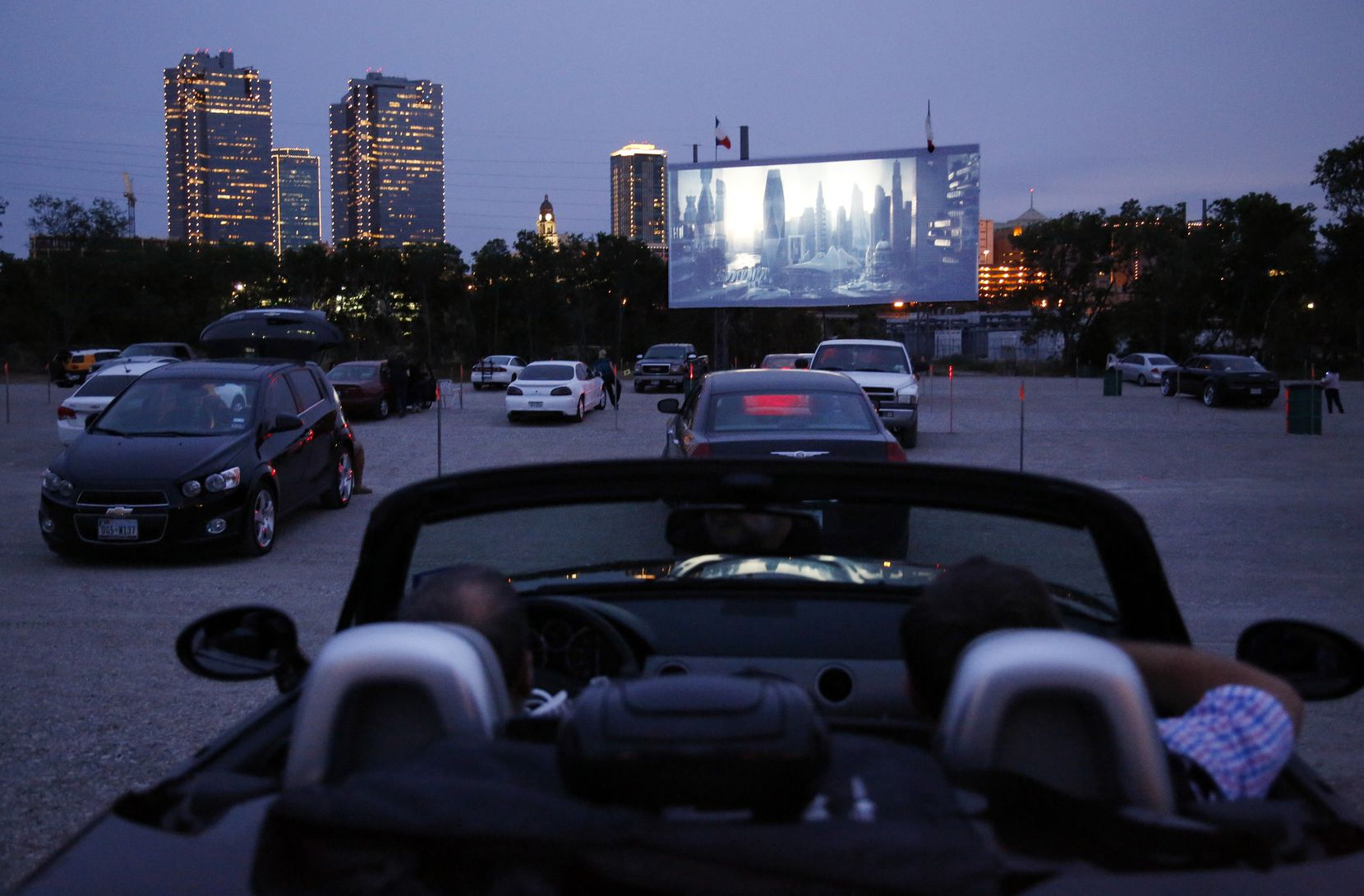 People watch the previews before the show while they visit the Coyote Drive-In in Fort Worth, TX on May 3, 2013. Background is downtown Fort Worth skyline. (Kye R. Lee/The Dallas Morning News) 05102013xBRIEFING 08152014xBRIEFING 01142015xARTSLIFE