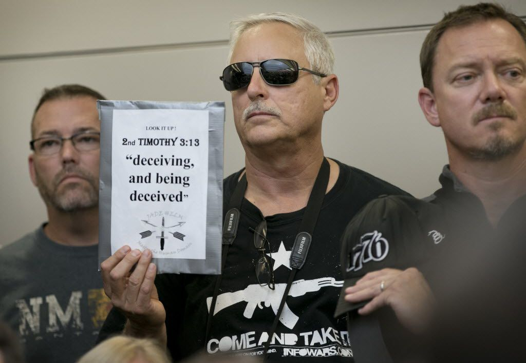 Bob Welch holds a sign at a public hearing about the Jade Helm 15 military training exercise in Bastrop, Texas, on April 27, 2015.