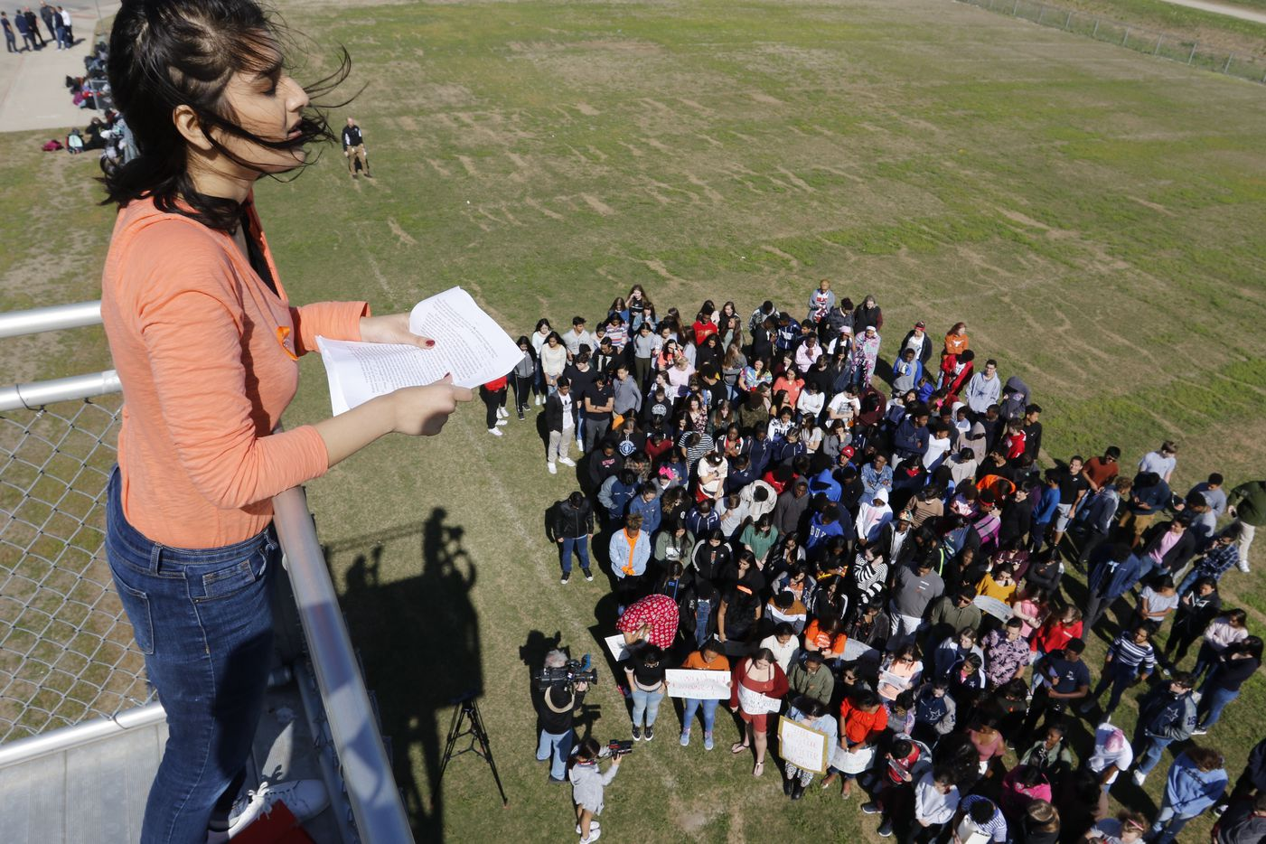 Frisco ISD Lone Star High School student, Hillary Shah, 17, leads the moment of silence in the National School Walkout in Frisco, Texas.
