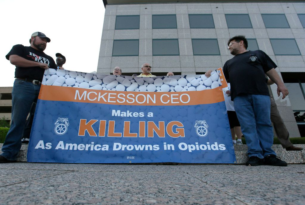 Teamsters protested outside the McKesson Corp. shareholders meeting Wednesday in Irving.  (LM Otero/The Associated Press)