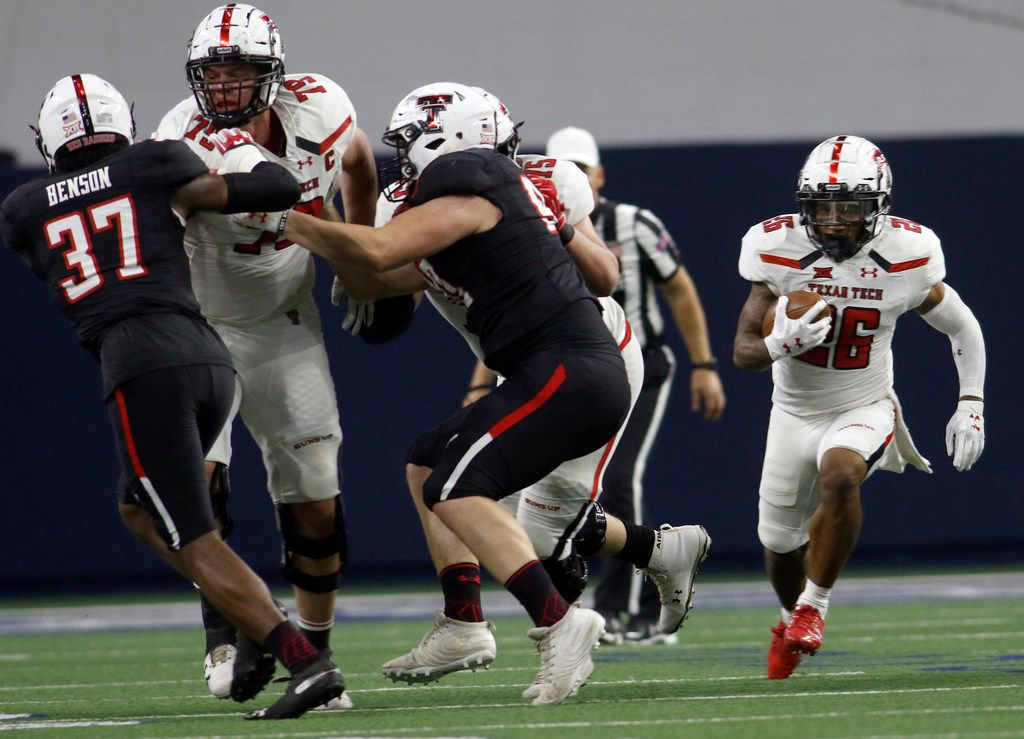Texas Tech running back Ta'Zhawn Henry (26) explores a running lane provided by offensive linemen Travis Bruffy (79) and Giovanni Pancotti (75) during first half play. The annual spring game for the Texas Tech football program was held at The Star in Frisco on April 13, 2019. (Steve Hamm/ Special Contributor)