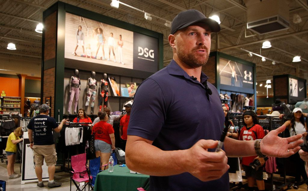 Dallas Cowboys tight end Jason Witten speaks with reporters after introducing the new DSG sporting goods line to representatives from the Mid-Cities Pee Wee Football Association. Witten was on hand to surprise a number of area youth by assisting with a shopping spree to promote a new athletic line. The event was held at Dick's Sporting Goods in Euless on August 19, 2019. (Steve Hamm/ Special Contributor)