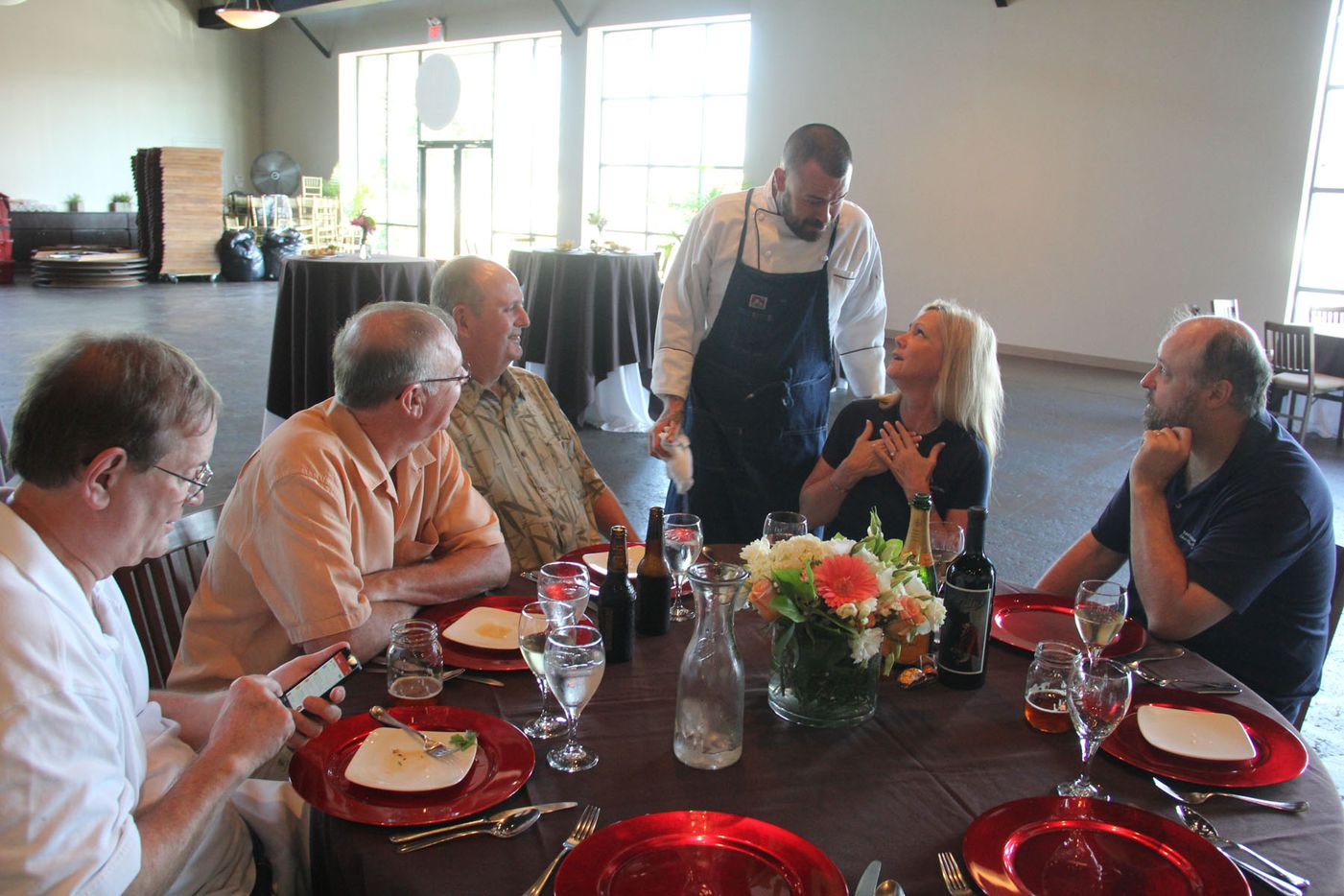 Chef Justin Box chats with guests at his summer pop up dinner Summer Shenanigans at 3015 in Trinity Groves on July 26,2015.