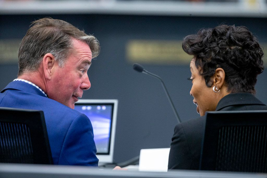 Ian McPherson, partner at KPMG, chats with Police Chief U. Reneé Hall before a City Council briefing on a Dallas Police Department staffing study on Monday, August 26, 2019.
