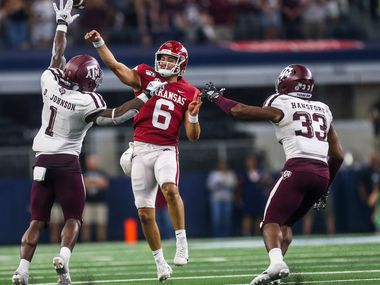 Arkansas Razorbacks quarterback Ben Hicks (6) makes a pass under a Texas A&M Aggies linebacker Buddy Johnson (1) pressure as Texas A&M Aggies linebacker Aaron Hansford (33) looks on during the second half of a NCAA football game between Texas A&M Aggies and Arkansas Razorbacks on Saturday, September 28, 2019 at AT&T Stadium in Arlington, Texas. (Shaban Athuman/Staff Photographer)