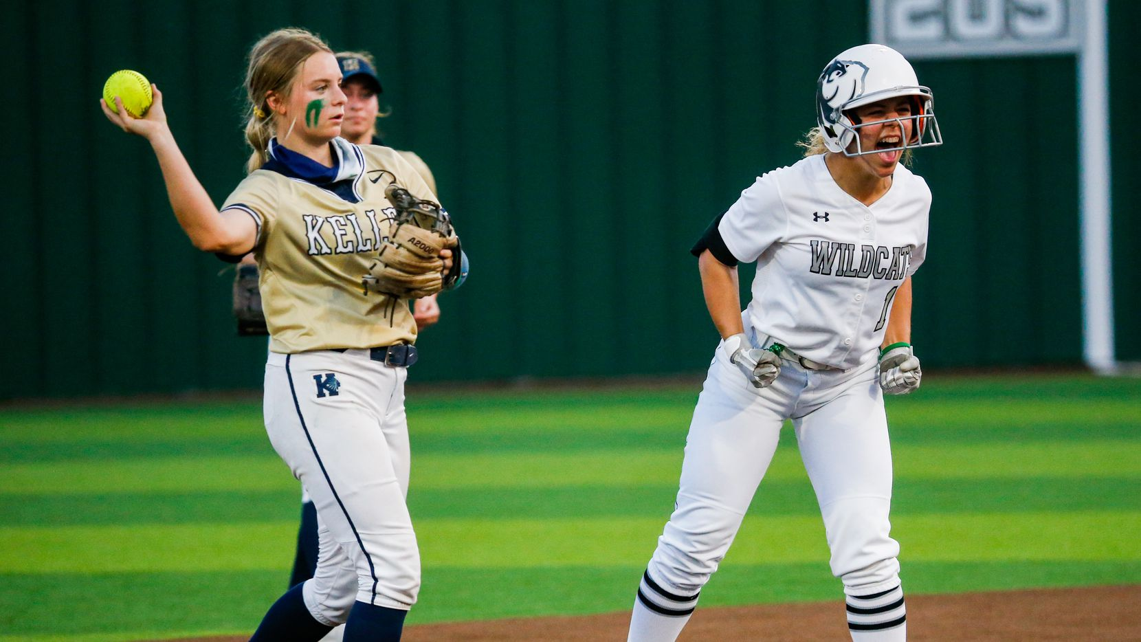 Denton Guyer's Avery Jefferson (1) celebrates a second base hit and her team's first run against Keller during the third inning of a non-district softball game in Denton on Tuesday, March 30, 2021.