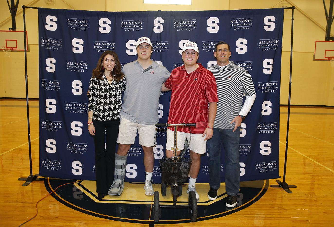 Fort Worth All Saints' Episcopal School offensive lineman Tommy Brockermeyer (center, left) and his twin brother James Brockermeyer both signed their national letters of intent with Alabama in the schools gymnasium, Wednesday, December 16, 2020. They are joined for a photo with their parents Kristy and Blake Brockermeyer. (Tom Fox/The Dallas Morning News)