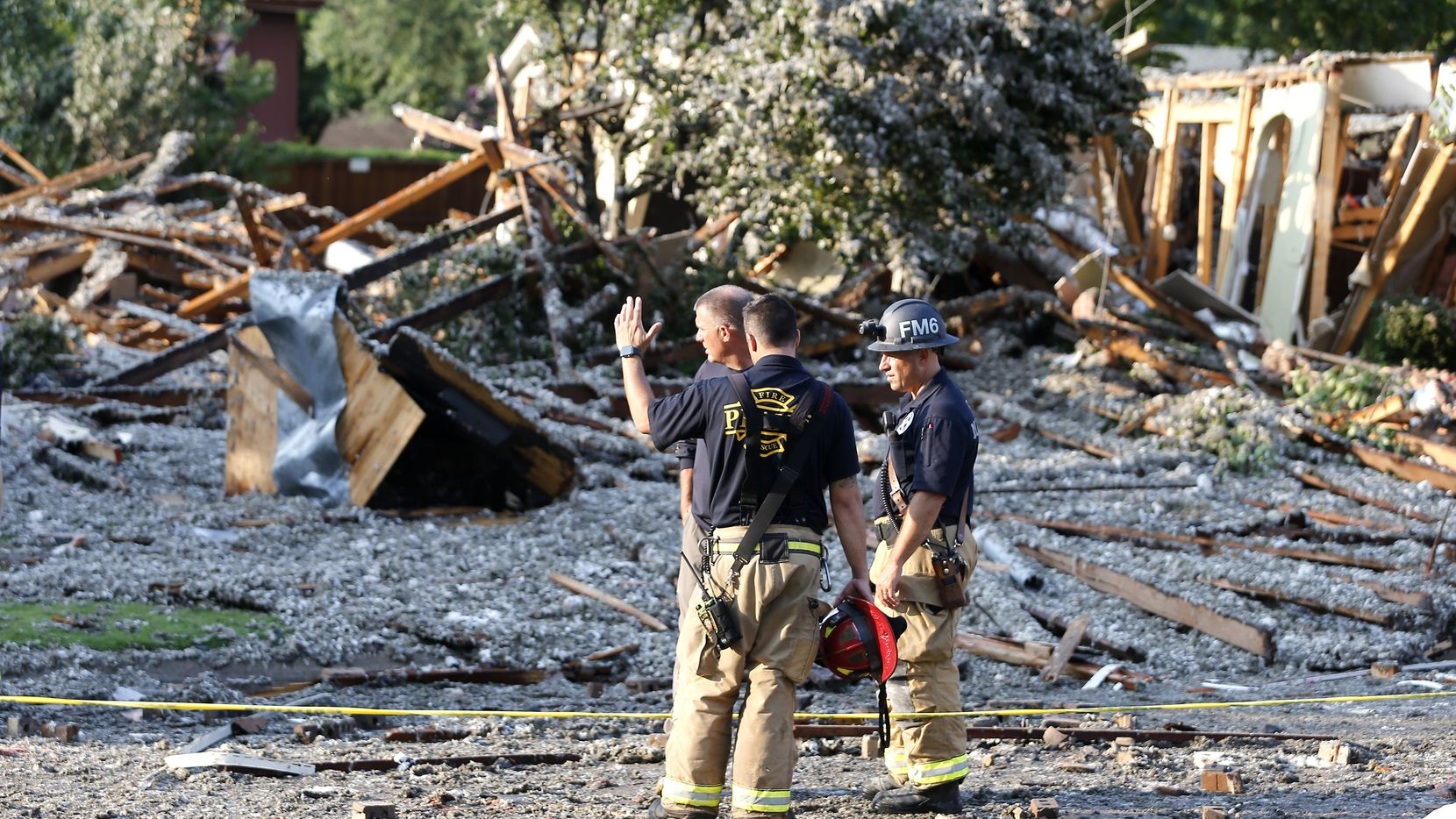 The Plano Fire Department works the scene after a home exploded at about 4:45 p.m. in the 4400 block of Cleveland Drive in Plano on Monday, July 19, 2021. (Stewart F. House/Special Contributor)