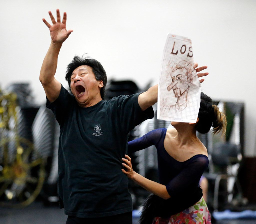 Holding a drawing of Pinocchio, assistant artistic director Li Anlin acts out a scene during rehearsal at Texas Ballet Theater.