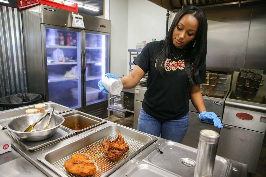 Carlonda Marshall of 2Neighbors Hot Chicken seasons chicken in DeSoto in late 2020.