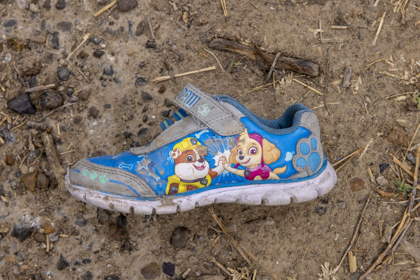 A single abandoned child's shoe is among the belongings left behind by migrants in the rural back roads of Roma, Texas, on Tuesday, March 30, 2021. The city has become a prime site for migrants crossing the Rio Grande river into the United States. A spike in the number of immigrants, from families to single adults to minors crossing the border alone, is expected to push border crossings to a 20-year record, says Homeland Security Secretary Alejandro Mayorkas of the new Biden administration.