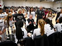 Bishop Lynch players huddle around head coach Andy Zihlman during a game against Plano Prestonwood Christian on Feb. 7, 2020. (Smiley N. Pool/The Dallas Morning News)