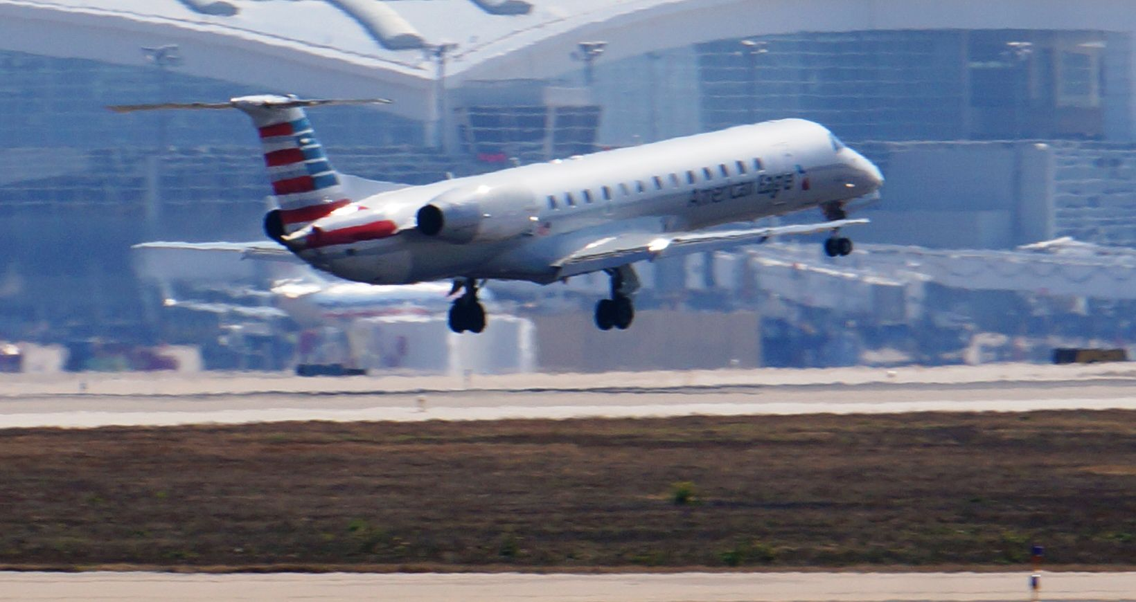American Airlines intends to transfer Embraer EMB-145 jets like this one to another carrier and end Envoy Air's New York operations. This photo was taken at Dallas/Fort Worth International Airport. (Terry Maxon/DMN)
