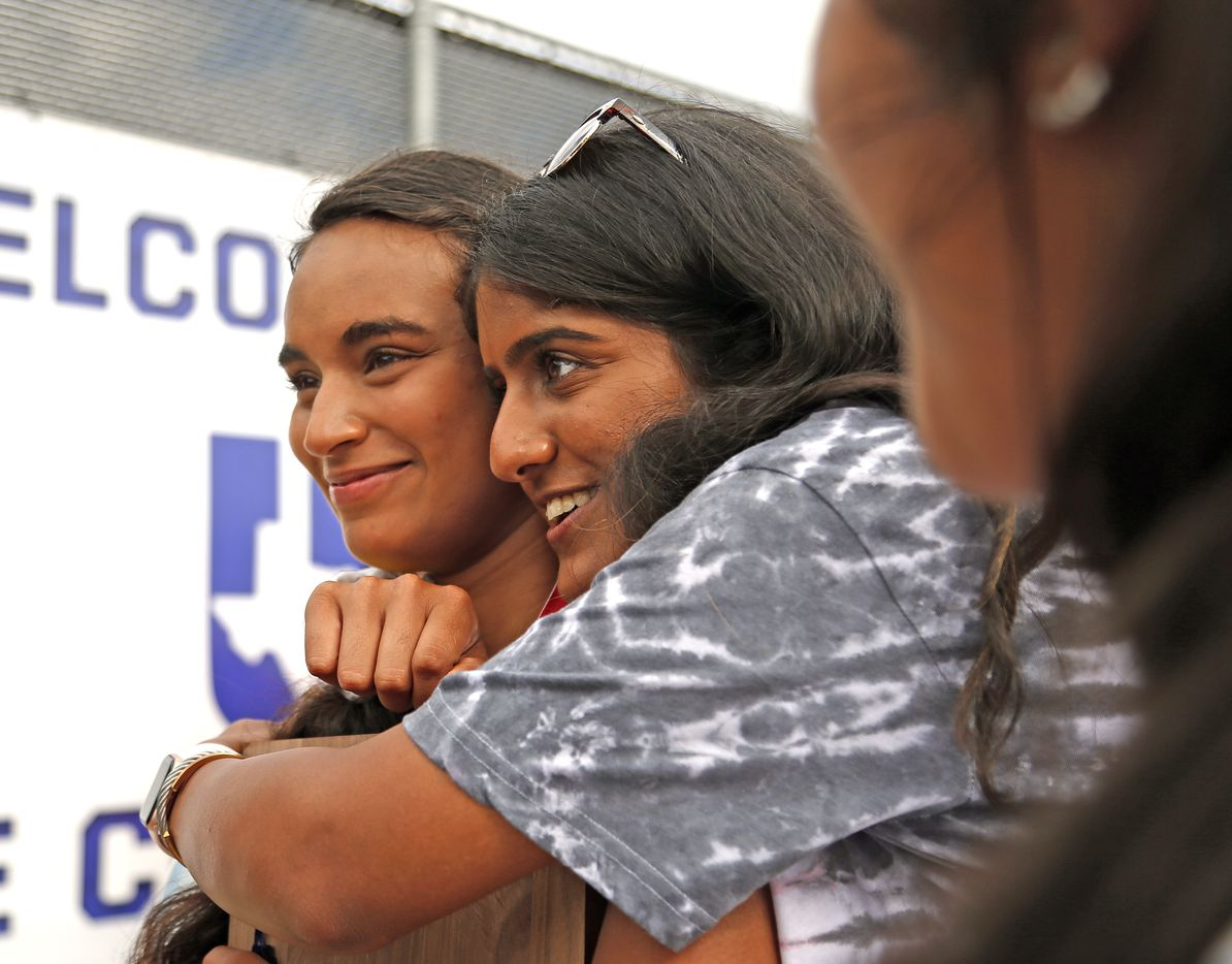 Frisco Heritage's Sriya Leesha Gourammagari is hugged by Saumya Vedula after she won the 5A girls singles title at the UIL State Tennis finals at Northside Tennis on Friday, May 21, 2021.