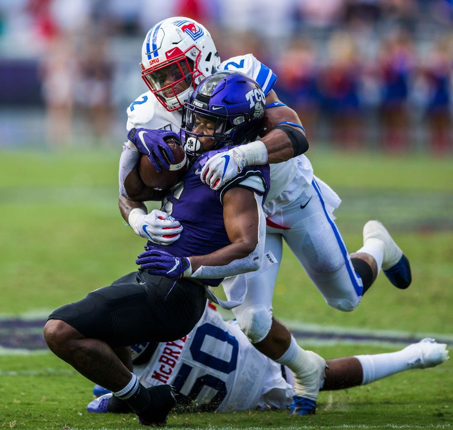 TCU Horned Frogs running back Darius Anderson (6) is tackled by Southern Methodist Mustangs safety Patrick Nelson (2) and linebacker Richard McBryde (50) during the second quarter of a college football game between SMU and TCU on Saturday, September 21, 2019 at Amon G. Carter Stadium in Fort Worth.