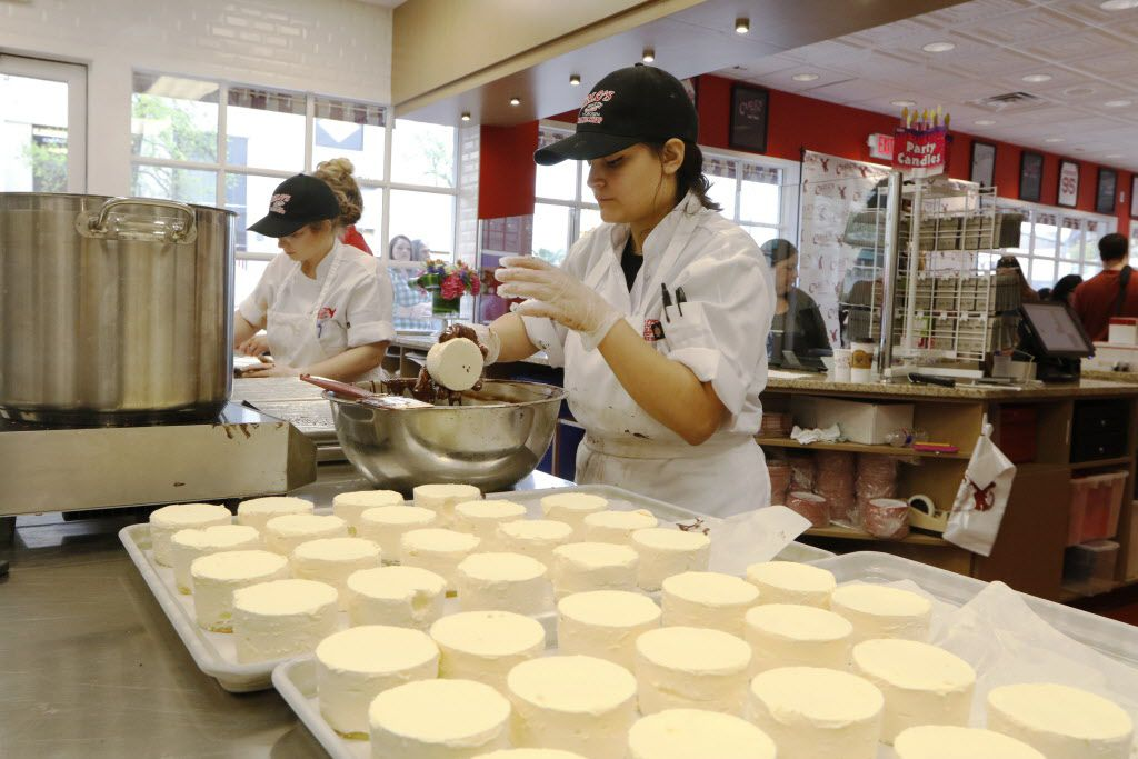 Rebekah Escamilla, right, prepares white mousse at Carlo's Bakery on Friday.