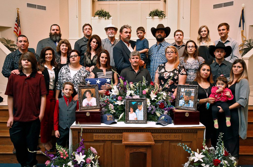 The Johnson Family pose for a portrait after the funeral of Dennis and Sara Johnson at First Baptist Church in Floresville, Texas on Nov. 12, 2017. The The Johnson's were killed in the First Baptist Church in Sutherland Springs, Texas the site of a shooting that killed 26 parishioners and left 30 injured. Top row (from left, starting with man with beard): Jason Wall, Aaron Staton, Butch Johns, Dennis Neil Johnson, Jr. (holding Savion Juarez), Michael Johnson, Jared Makohan, Taylor Johnson, Devon Johnson. Middle row: Michael Deaton, Katrina Johns-Sadler, Ruth Johns, Kati Wall, (slightly up) Lynn Dormer, Deanna Staton, Jimmy Graham, Leah Johnson, Leticia Blanchard, Christopher Ryan Johnson. Bottom row: Robert Deaton, Caleb Deaton, Kassandra Johnson (holding Loveen Johnson), Scarlet Patterson. (Nathan Hunsinger/The Dallas Morning News)