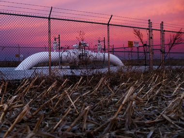 A Dakota Access pipeline valve sits in a cornfield as the sun rises in Mount Sterling, Ill.