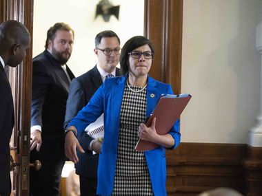 State Reps. John Bucy, D-Austin, Rafael Anchia, D-Dallas, and jessica Gonzalez, D-Dallas, leave a Democratic caucus meeting with the House Speaker Dade Phelan during negotiations on SB 7 the election reform bill on May 30, 2021.