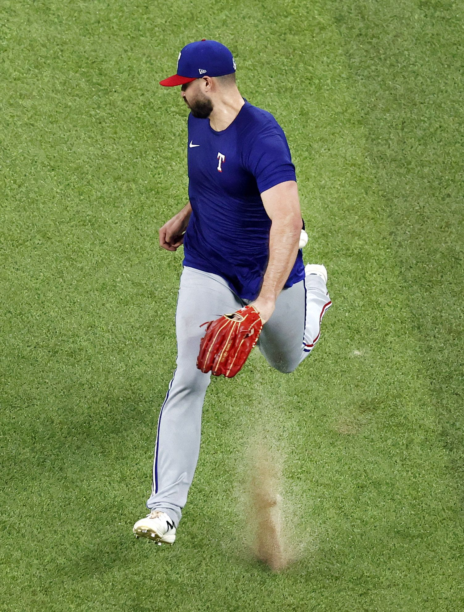 Texas Rangers outfielder Joey Gallo tries to field a fly ball on the hop during Summer Camp practice inside Globe Life Field in Arlington, Texas, Friday, July 10, 2020. Gallo chased it down while looking up at stadium's new roof. Gallo made his first appearance after clearing the COVID-19 intake process but did not participate in the simulated game. (Tom Fox/The Dallas Morning News)