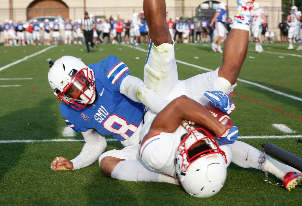 "SMU receiver CJ Sanders (1) is upended by SMU defensive back Rodney Clemons (8) after making a diving catch near the sideline. The SMU Mustangs Football team held an ""open practice"" in place of the originally scheduled spring game at SMU's Pettus Practice Fields in Dallas on April 12, 2019. (Steve Hamm/ Special Contributor)"