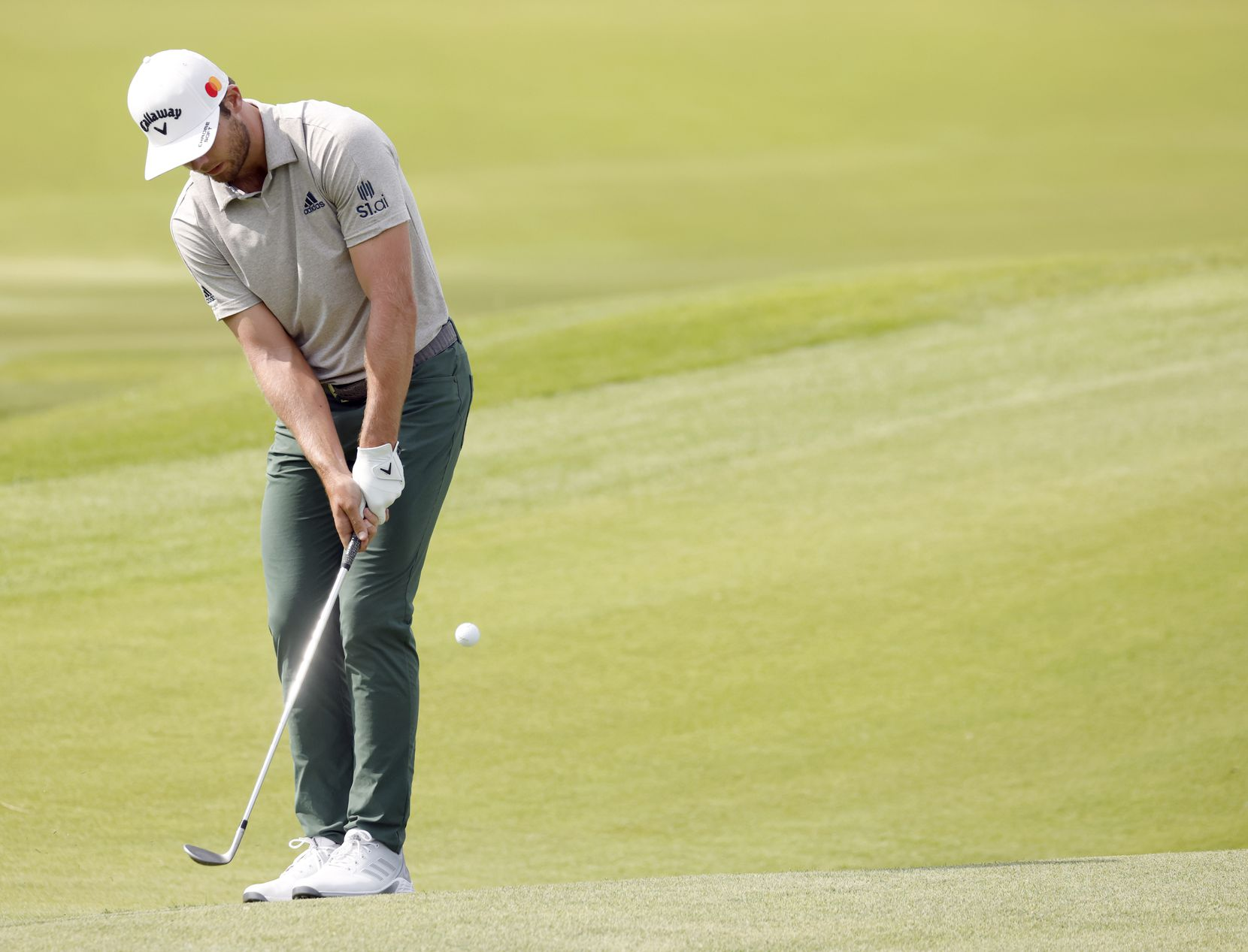 Sam Burns putts on the 16th hole during round 3 of the AT&T Byron Nelson  at TPC Craig Ranch on Saturday, May 15, 2021 in McKinney, Texas. (Vernon Bryant/The Dallas Morning News)