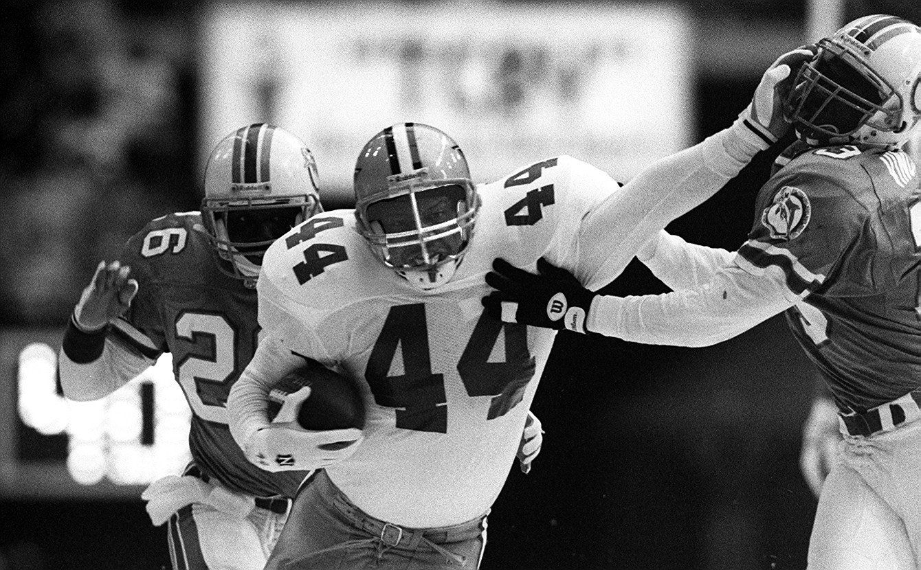 Lincoln Coleman stiff-arms Dolphins cornerback Troy Vincent as strong safety Jarvis Williams closes in from behind during the 1993 Thanksgiving Day game. Despite the fact that it ended with a 17-16 Cowboys loss, the game would be the highlight of Coleman's pro career.