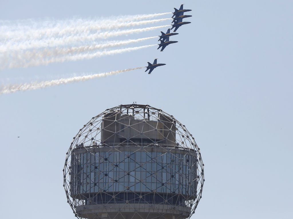 The U.S. Navy Blue Angels fly over Reunion Tower and the Dallas skyline on Wednesday, May 6, 2020.