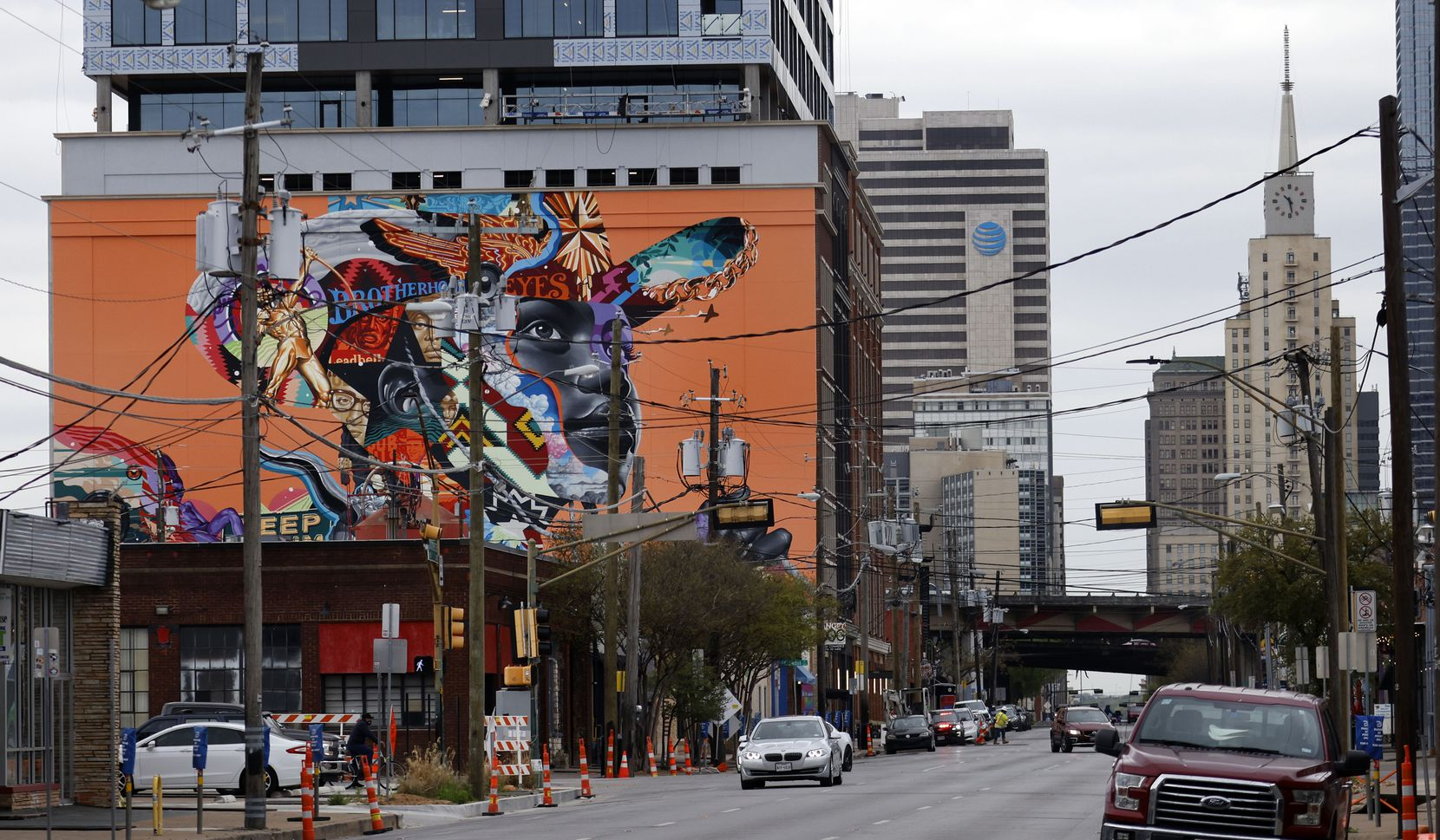 An 8,500-square-foot mural by artist Tristan Eaton is painted on The Stack building on Commerce Street in the Deep Ellum area of Dallas. Proposed change to highways could better connect Deep Ellum to both South Dallas and the Central Business District. (Tom Fox/The Dallas Morning News)