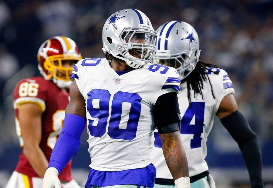 FILE - Dallas Cowboys defensive end Demarcus Lawrence (90) smiles after making a first half play against the Washington Redskins at AT&T Stadium in Arlington, Texas, Thursday, November 22, 2018. (Tom Fox/The Dallas Morning News)