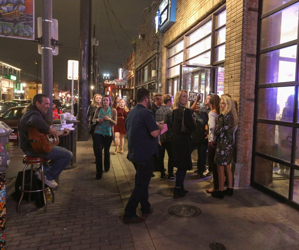 A crowd forms a Chill 360 on Elm Street in Deep Ellum on Friday, Jan. 26, 2018.