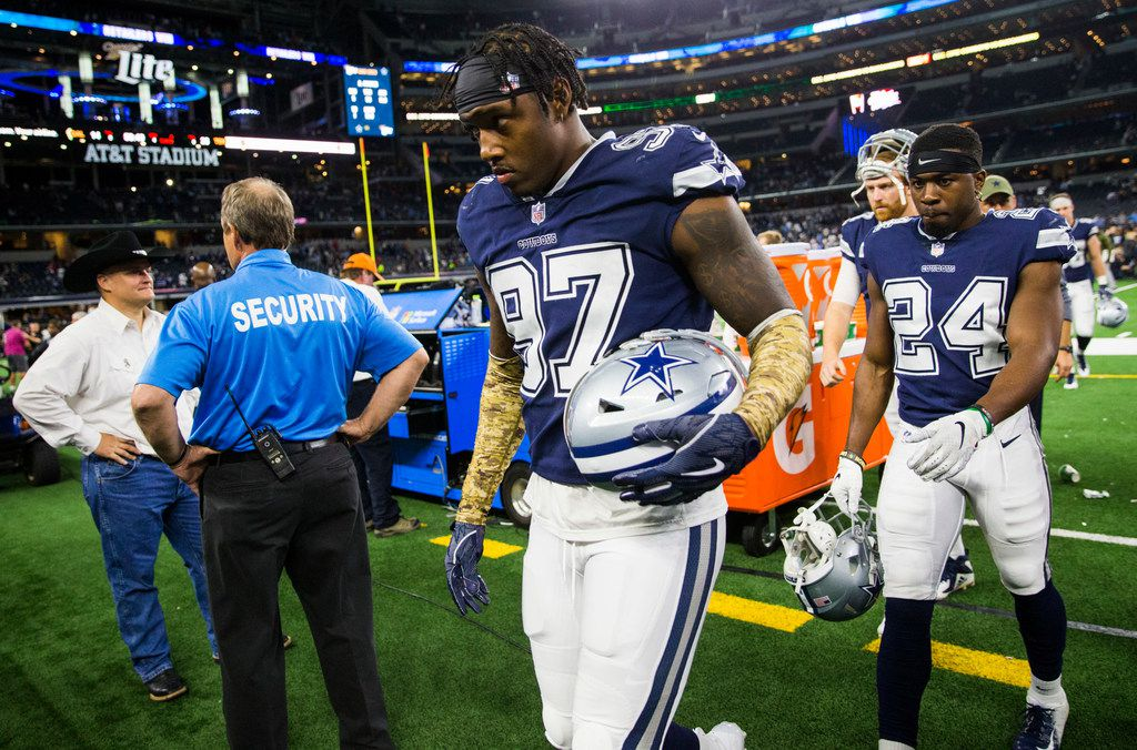 Dallas Cowboys defensive end Taco Charlton (97) and cornerback Chidobe Awuzie (24) leave the field after a 28-14 lost to the Tennessee Titans on Monday, November 5, 2018 at AT&T Stadium in Arlington, Texas. (Ashley Landis/The Dallas Morning News)