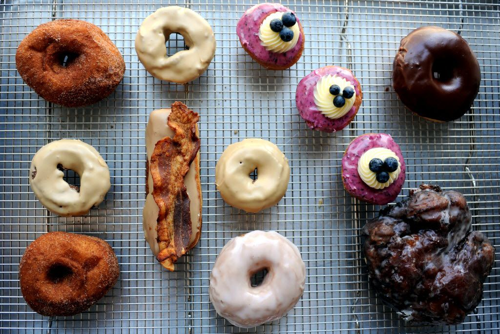 Glazed Donut Works hand crafted donuts range from a Maple Bacon Long John to a vegan Watermelon donut. The bakery is located on Elm Street in Deep Ellum Dallas, TX with morning and late night hours and a menu that changes daily.