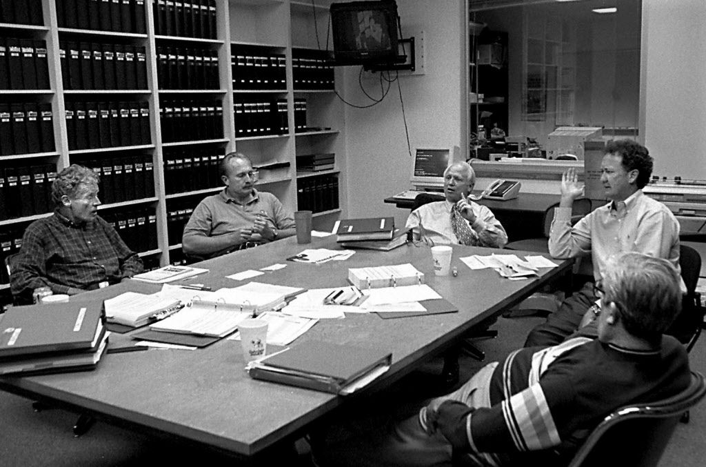 4/17/95--(l to r) Dallas Cowboys' scouts  Jim Garrett, Tom Ciskowski, Larry Lacewell, Walter Juliff and  Walt Yowarsky discuss the upcoming draft in the 'war room' at  Valley Ranch Monday afternoon.  Louis DeLuca/The Dallas Morning News.   (Taken 4/17/95)