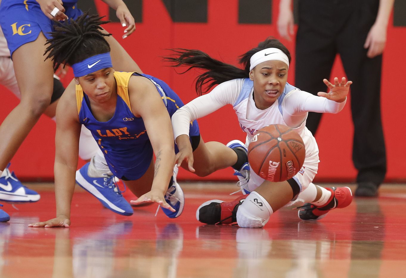 Lakeview Centennial junior Taliyah Harris, left, and Skyline sophomore Kennedi Johnson vie for a loose ball during a girls basketball first-round playoff game at Hillcrest High School in Dallas, Saturday, February 13, 2021. Skyline won 49-42. (Brandon Wade/Special Contributor)