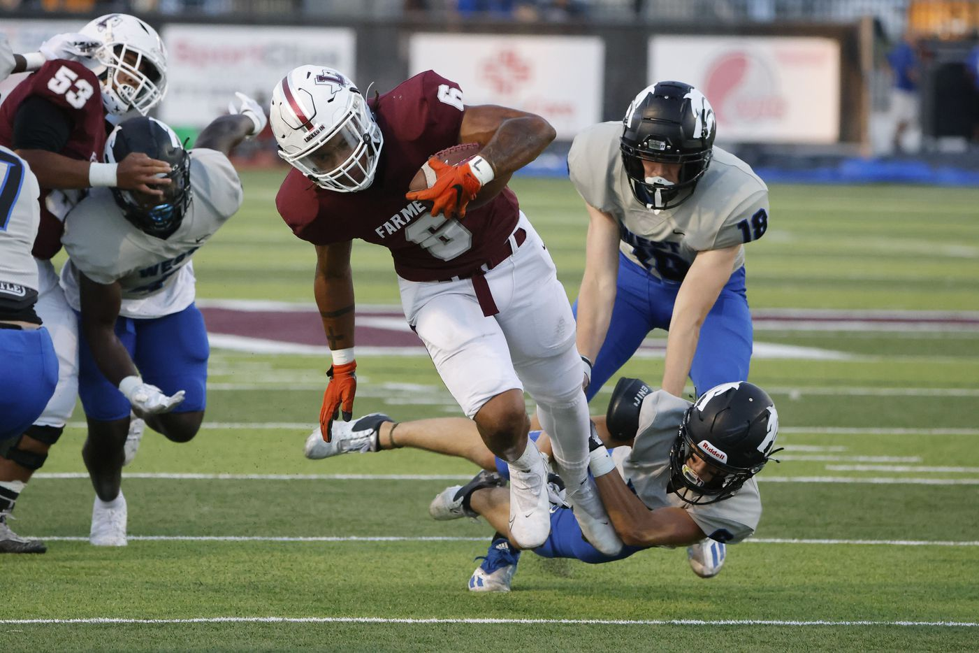 Lewisville running back Damien Martinez (6) runs out of an attempted tackle by Plano Wesd defender Coby Stewart during the first half of a high school football game in Lewisville, Texas on Friday, Sept. 24, 2021. (Michael Ainsworth/Special Contributor)