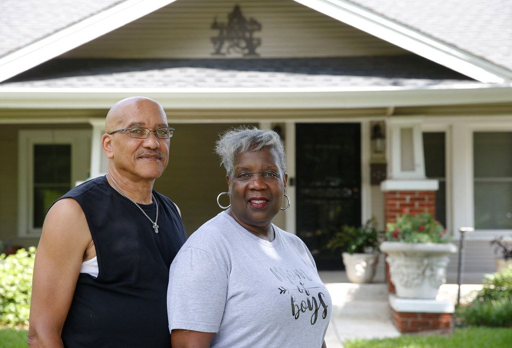 Arnold and Jackie Abney in front of their Park Row home of 24 years, only a few blocks away from Jim's Car Wash.