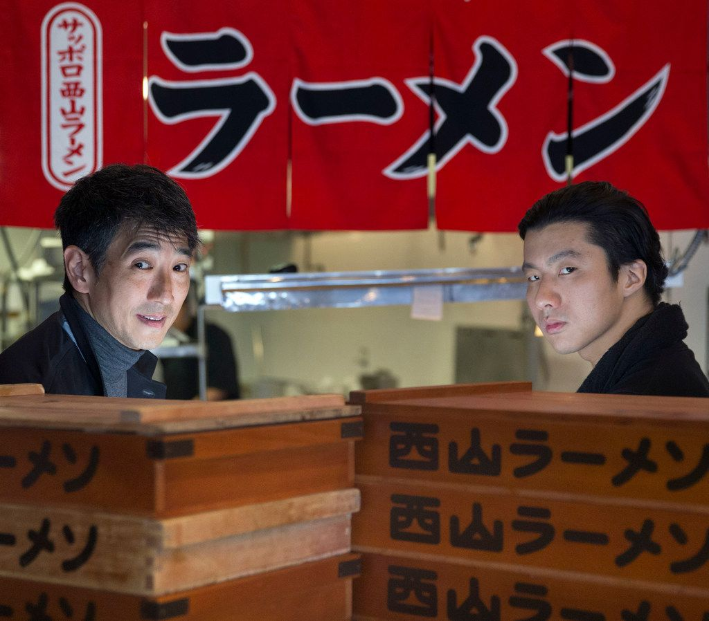 George Itoh, left, and chef Andy Tam are opening Ichigoh Ramen Lounge in Deep Ellum. The antique cedar boxes are used to age ramen noodles.