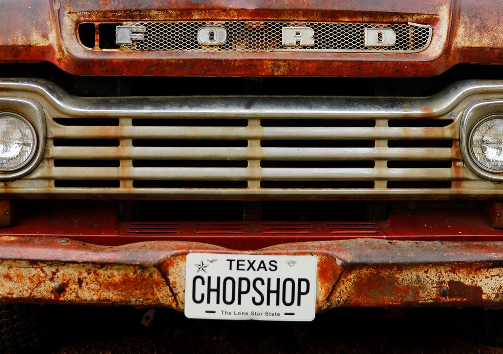 An old Ford pickup sits at the entrance to ChopShop Live in Roanoke, Texas, Friday, July 6, 2018. (Tom Fox/The Dallas Morning News)