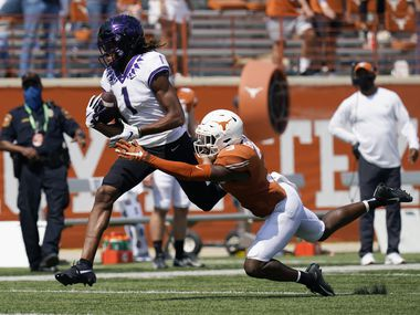 FILE - TCU wide receiver Quentin Johnston (1) reaches to catch a pass over Texas defensive back Jalen Green (3) during the first half of a game on Saturday, Oct. 3, 2020, in Austin. Johnston was tripped up on the play and dropped the ball. (AP Photo/Eric Gay)
