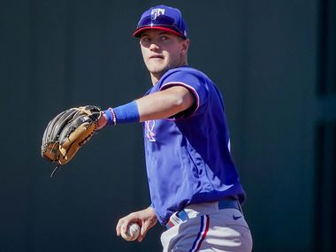 Texas Rangers infielder Josh Jung warms up at third base during the fifth inning of a spring training game against the Kansas City Royals at Surprise Stadium on Sunday, Feb. 28, 2021, in Surprise, Ariz. (Smiley N. Pool/The Dallas Morning News)