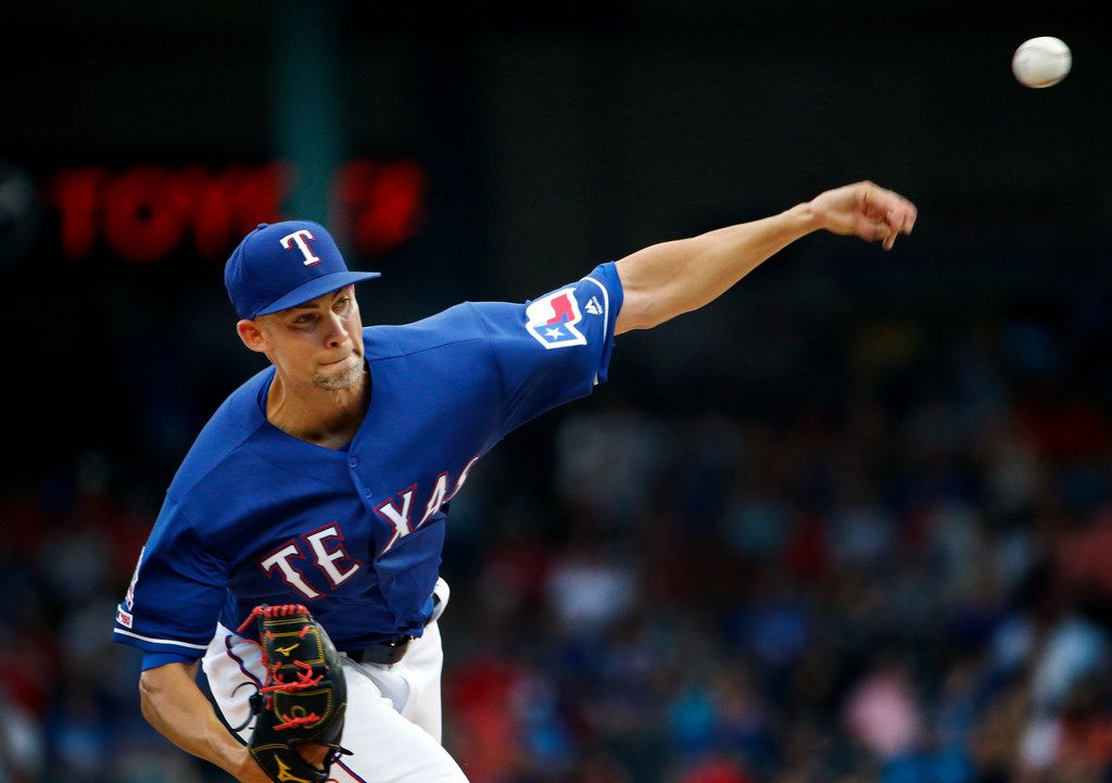 Texas Rangers starting pitcher Mike Minor (23) throws against the Houston Astros in the second inning at Globe Life Park in Arlington, Texas, Saturday, July 13, 2019.  (Tom Fox/The Dallas Morning News)