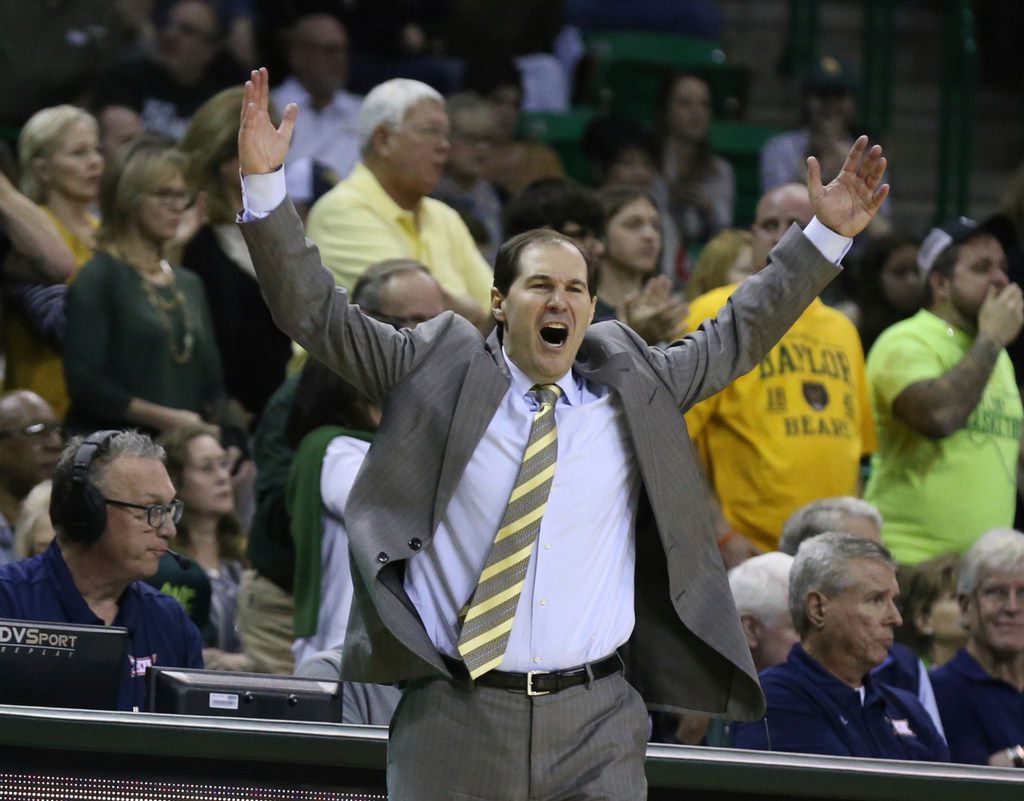 Baylor head coach Scott Drew fires up the crowd after a score against West Virginia in the second half of an NCAA college basketball game, Saturday, Feb. 23, 2019, in Waco, Texas. Baylor won 82-75. (Rod Aydelotte/Waco Tribune-Herald via AP)