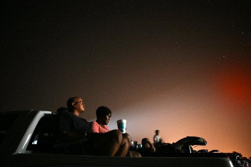 As stars light the sky, Ken Bartlette and his wife, Tammie Bartlette, from Dallas, watched the movie Transformers: Revenge of the Fallen from the back of their truck at the Galaxy Drive-In in Ennis, Texas on June 26, 2009.