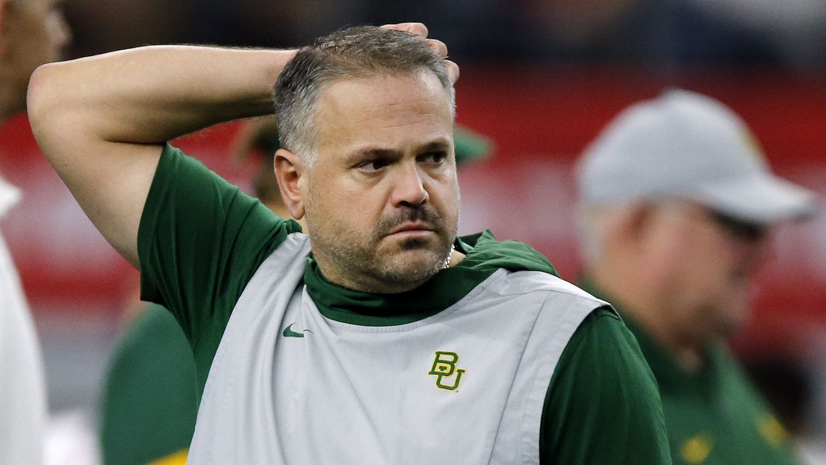Baylor Bears head coach Matt Rhule watches his team during warm up before facing the Oklahoma Sooners in the Big 12 Championship at AT&T Stadium in Arlington, Saturday, December 7, 2019.
