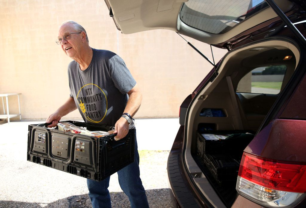Volunteer Duane Landa unloads a delivery of donated goods from Tom Thumb at the NTX Community Food Pantry in The Colony.